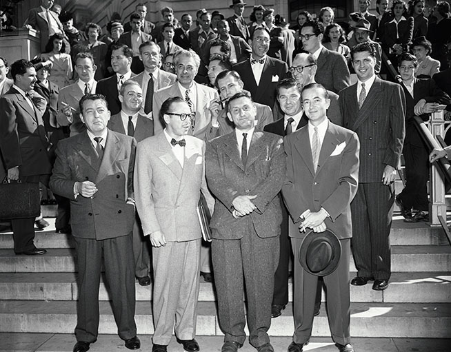 Washington, DC, USA --- Original caption: 10/27/47-Washington, DC: The group of Hollywood writers and producers summoned to appear before the House Un-American Activities Committee in probe of communism in the film city, are shown as they left the investigation late today. Front row: Lewis Milestone, Dalton Trumbo, John H. Lawson, who was cited for contempt, and Bartley Crum, attorney for witnesses. Center row: Gordon Kahn, Irving Pichel, Edward Dmytryk, Robert Rossen. Top row: Waldo Salt, Richard Collins, Howard Koch and Albert Maltz; Herbert Biberman; Lester Cole and Ring Lardner, Jr., writers and Martin Popper, another attorney for the group. Photo by G.B. Kress --- Image by © Bettmann/CORBIS