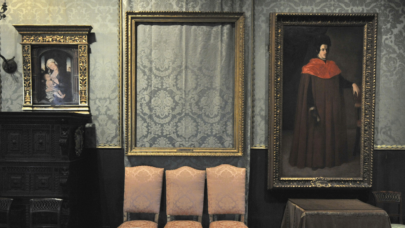 The empty frame from which thieves cut Rembrandt's The Storm on the Sea of Galilee remains on display at the Isabella Stewart Gardner Museum in Boston. The painting was one of 13 works stolen from the museum in 1990